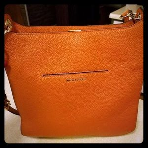 Michael Kors leather satchel purse.